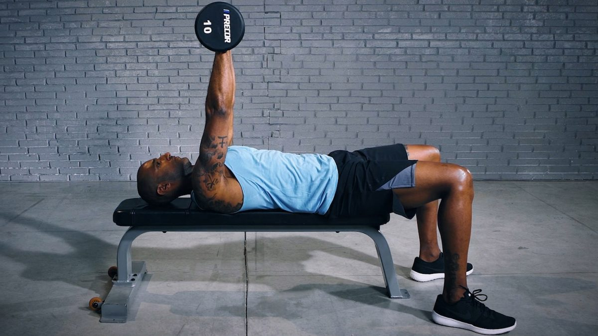 Man showcasing dumbell chest press