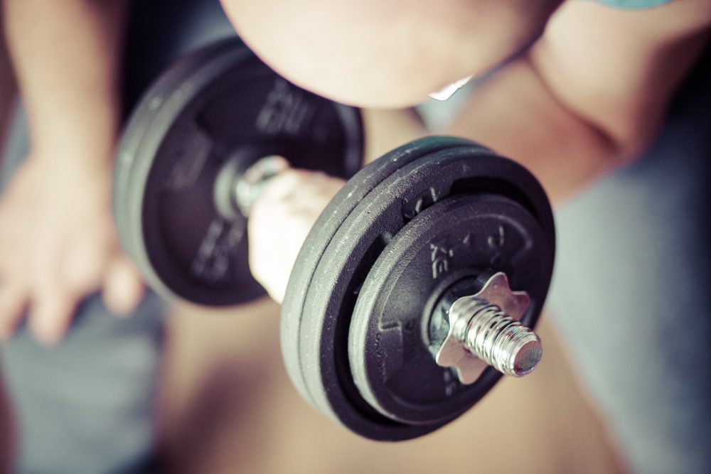 Man training with dumbells
