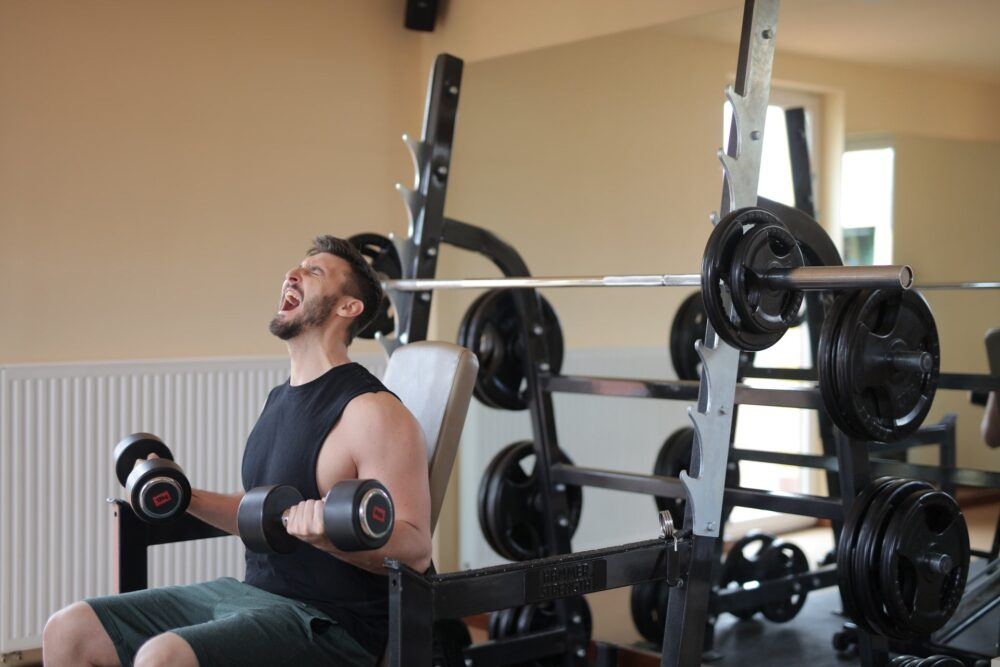 Man sitting on exercise equipment